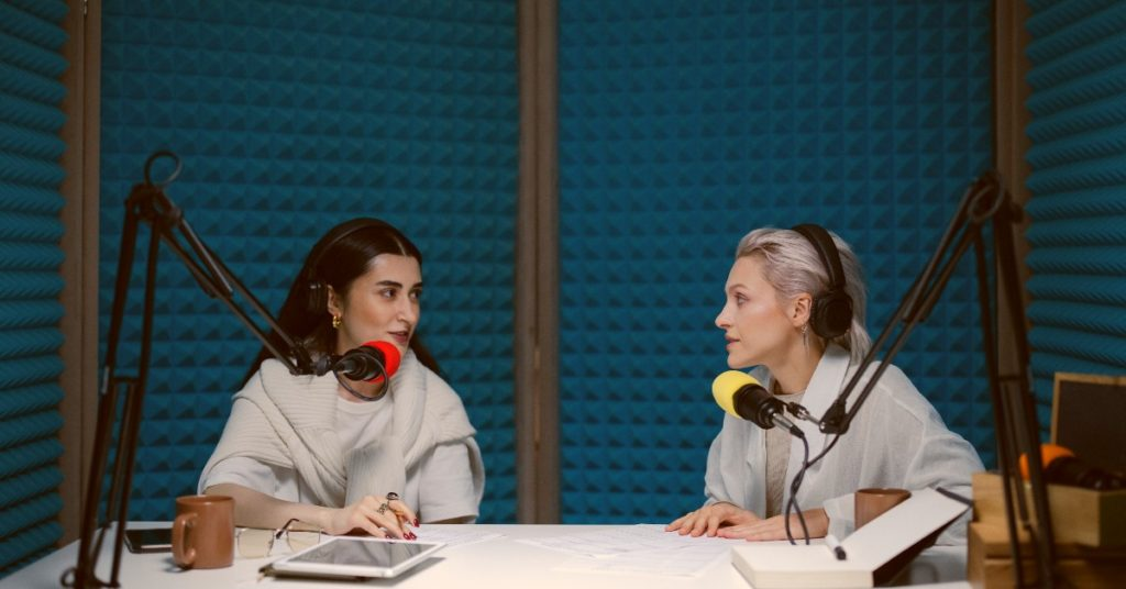 two-women-recording-in-person-podcast-episode