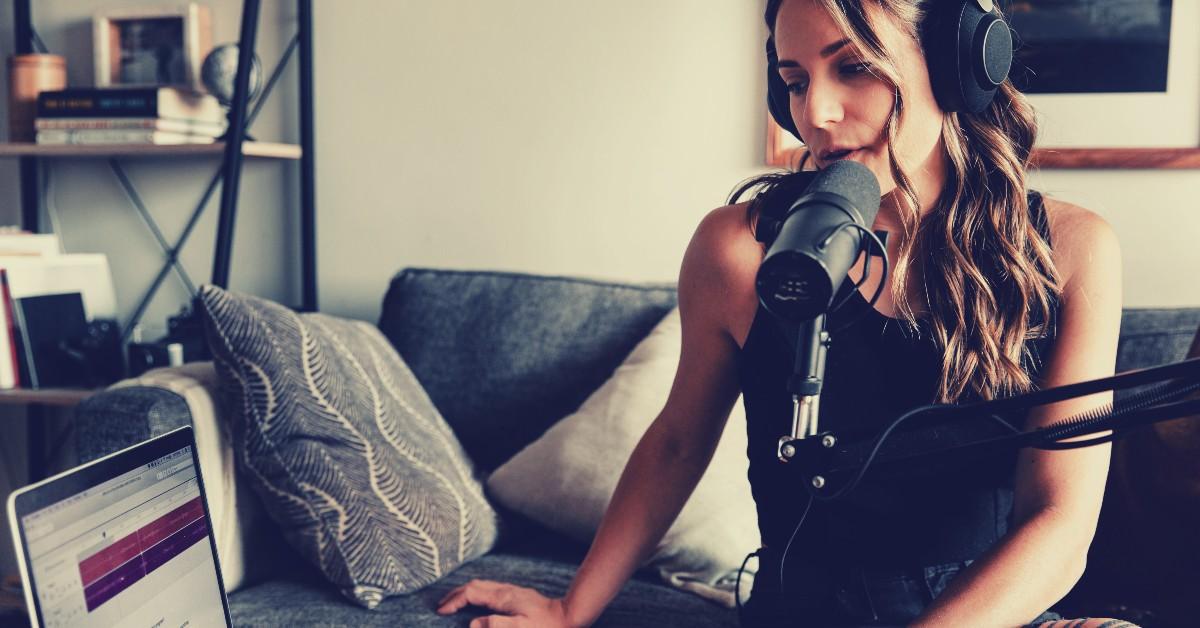 girl-speaking-into-mic-wearing-headphones